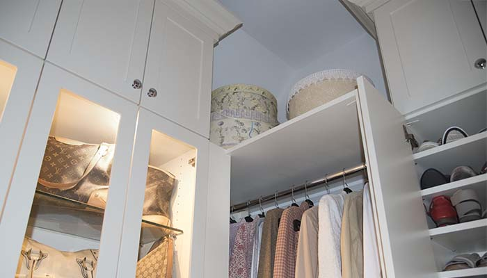 custom walk in closet offers overhead closet storage