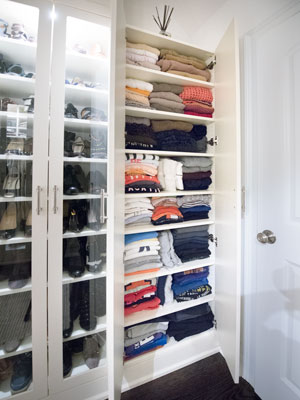 custom walk in closet with cabinet for sweaters and folded clothing