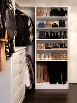 master walk in closet with adjustable shoe shelves