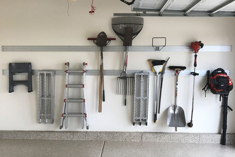 custom garage wall organization system for lawn and garden tools