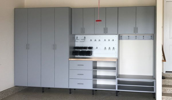 garage workbench with entryway storage and wall track systems