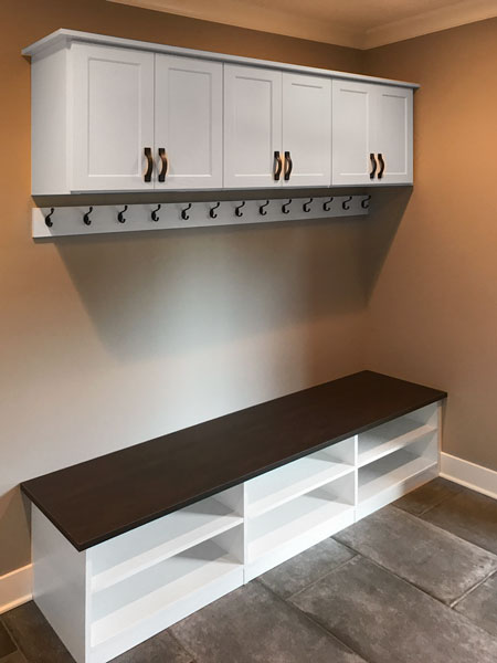 Closet desk with upper cabinets featuring strap handles in oil rubbed bronze