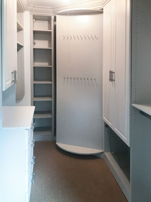small walk in closet with customized rotating shoe storage
