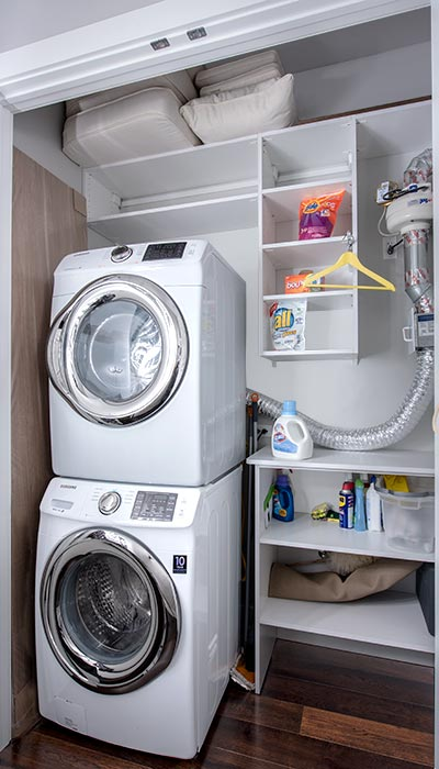 Custom laundry closets add storage to a small closet laundry room