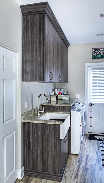Laundry room cabinets and orgaizational shelves in Merapi thermally fused laminate - TFL
