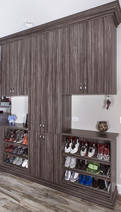 Custom mud room shoe storage and cabinets
