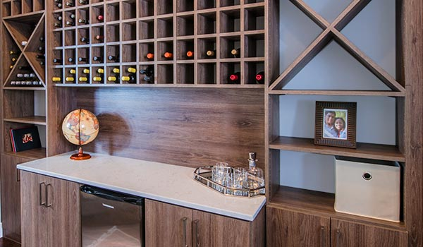 Custom wall unit provides wine cellar and storage