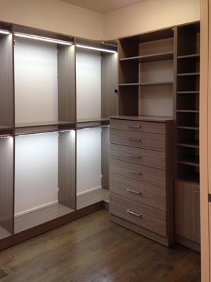 custom closet organization system with overhead lights