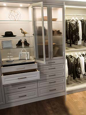 wardrobe style closet with custom lighting system
