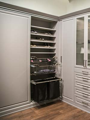wardrobe style closet with laundry bin, shoe shelves and pull-outs