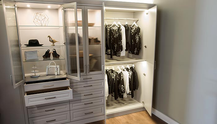 Wardrobe system styled as free standing closets with LED closet lighting system