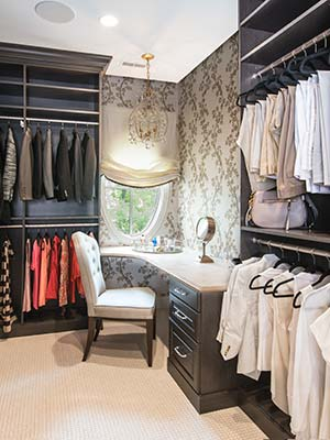 custom closet with dressing table, triple hutch and shoe spinner