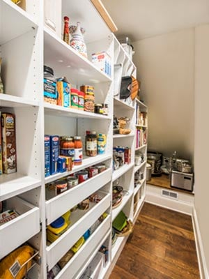 long and narrow pantry with sloped ceiling
