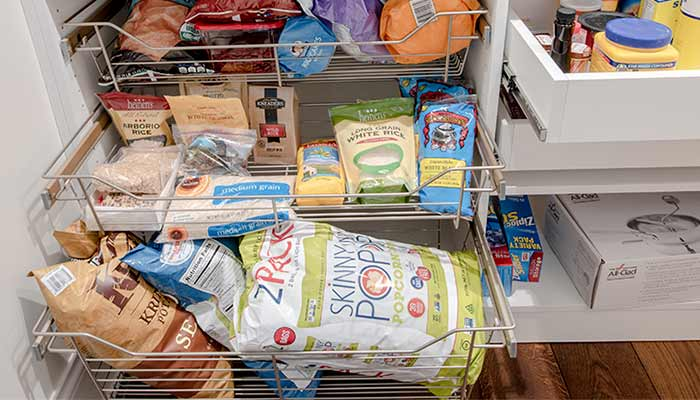 pull-out wire basket for pantry with bags of chips