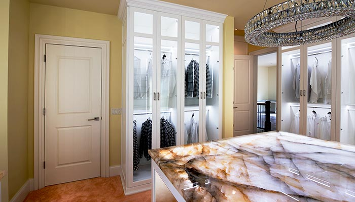 Glass panel cabinet doors in custom closet system