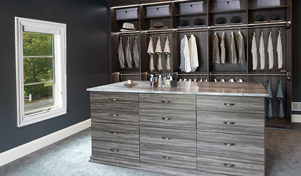Custom walk-in closet designs and dressing room with elaborate walk-in closet lighting system