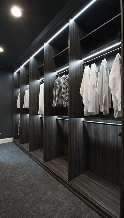 Double Hang Section Of Master Closet With Walk In Closet Lighting
