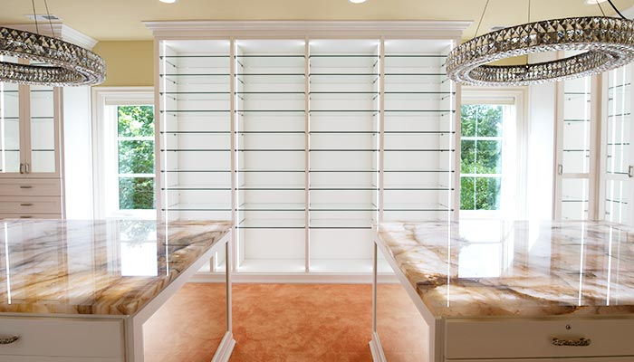 Wall of glass shoe shelves and closet shoe organization system