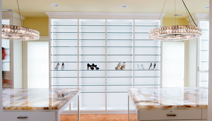 custom glass shelving unit for walk in closet organization