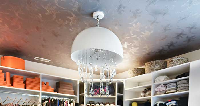 luxury master closet ceiling with personalized decor
