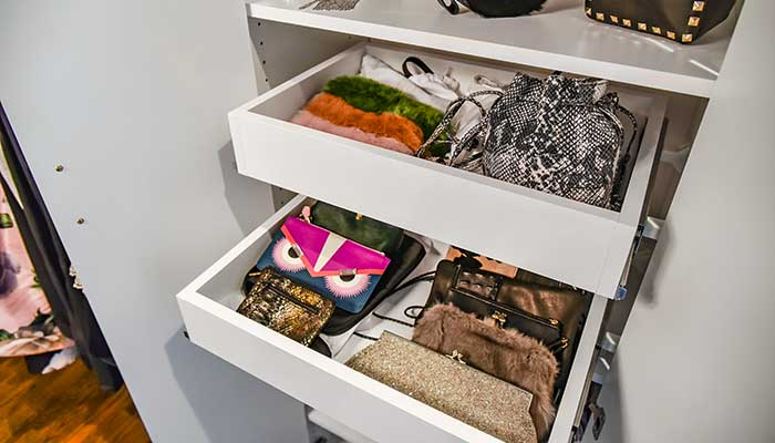 small handbag storage using pull-out shelves