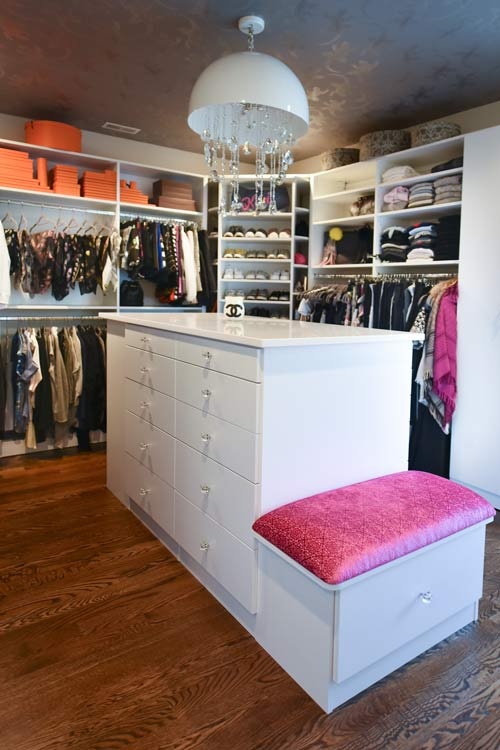 walk in closet with custom closet island