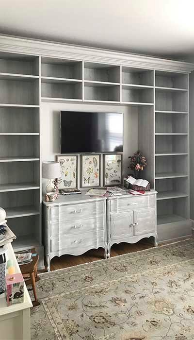 custom living room wall unit with shelves to match decor