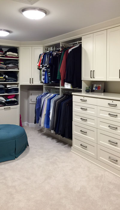 custom dressing room closet with hat rack and shoes storage