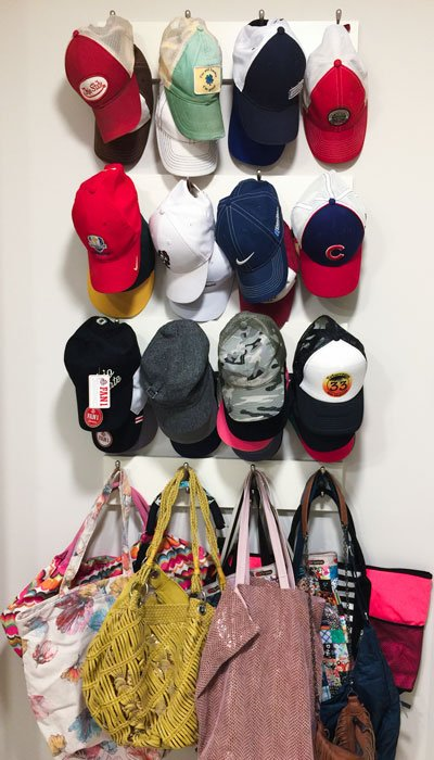 Hat collection on hooks in walk-in closet