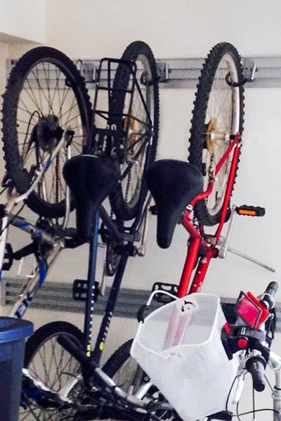 bicycles stored with the Omni Track aluminum wall track garage organization system