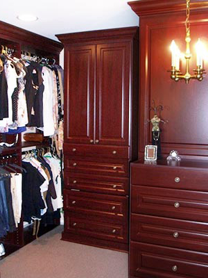 Custom closet organization system in real wood and furniture type accessories