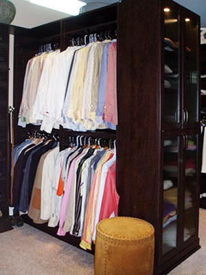Two person custom closet organization system separates for his and her spaces
