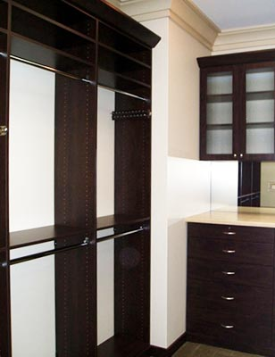 Custom closet organization system with reeded glass doors
