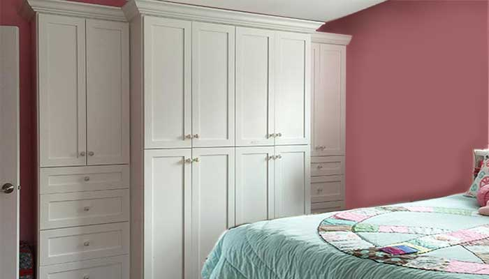Add a wardrobe closet for additional storage in a small bedroom