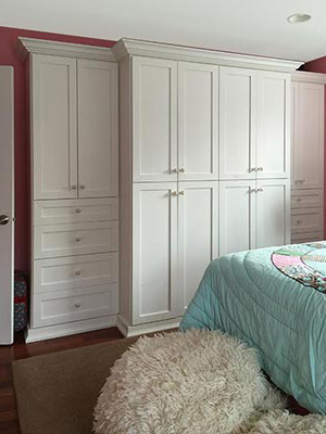wardrobe style closet organization system adds storage to room without regular closet