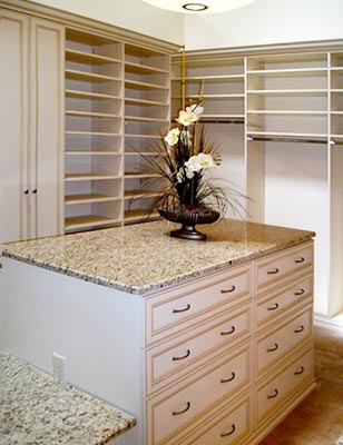 Custom closet organization system in portabella ivory