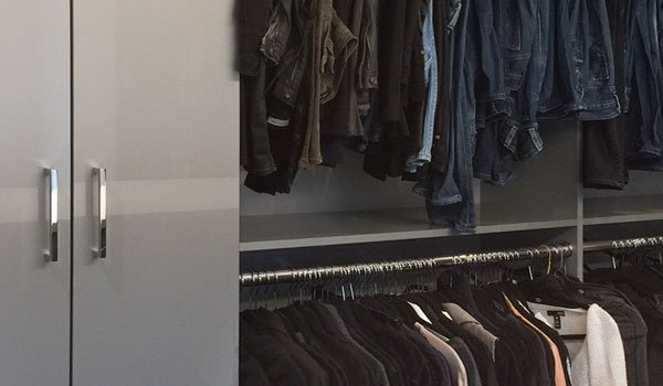 high gloss walk in closet ideas with closet island and cabinets