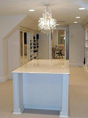 custom closet design for room with with angled ceilings