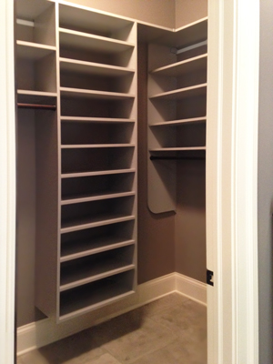 corner wrapped closet with shoe shelving section