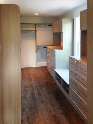 walk-in closet with shoe cubbies and bench