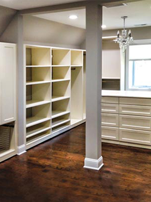 custom closet organization system in ivory thermally fused laminate (TFL)