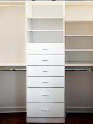 custom white reach-in closet organization system with six drawers