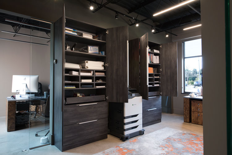 custom office cabinets open displaying cubbies and pull outs
