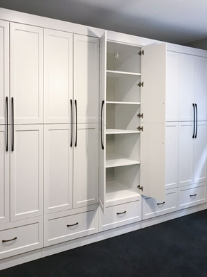 custom basement wardrobe organization system
