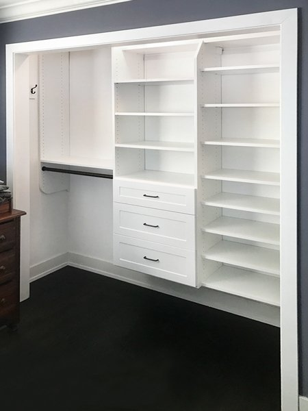 reach-in closet idea with a shoe tower and closet drawers