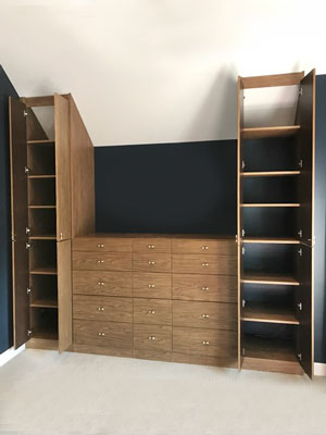 custom wall unit for slanted ceiling room