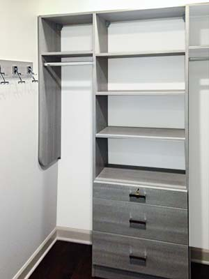 sophisticated gray wood tone custom master closet system