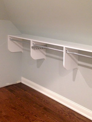 walk-in sloped ceiling closet hanging solution