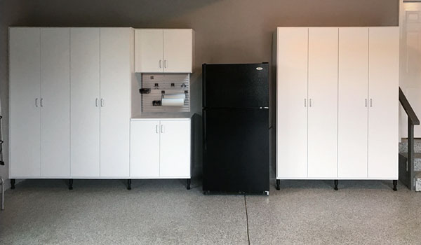 white garage cabinets with storgage solutions and workbench
