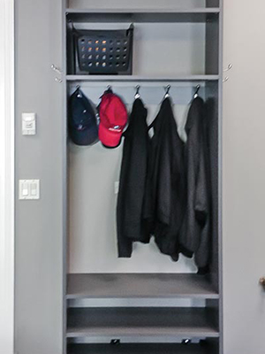 custom garage with hooks and shelves